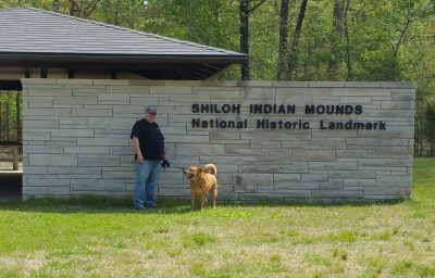 Jim and Chewie in front of Interpretive Building for Mounds